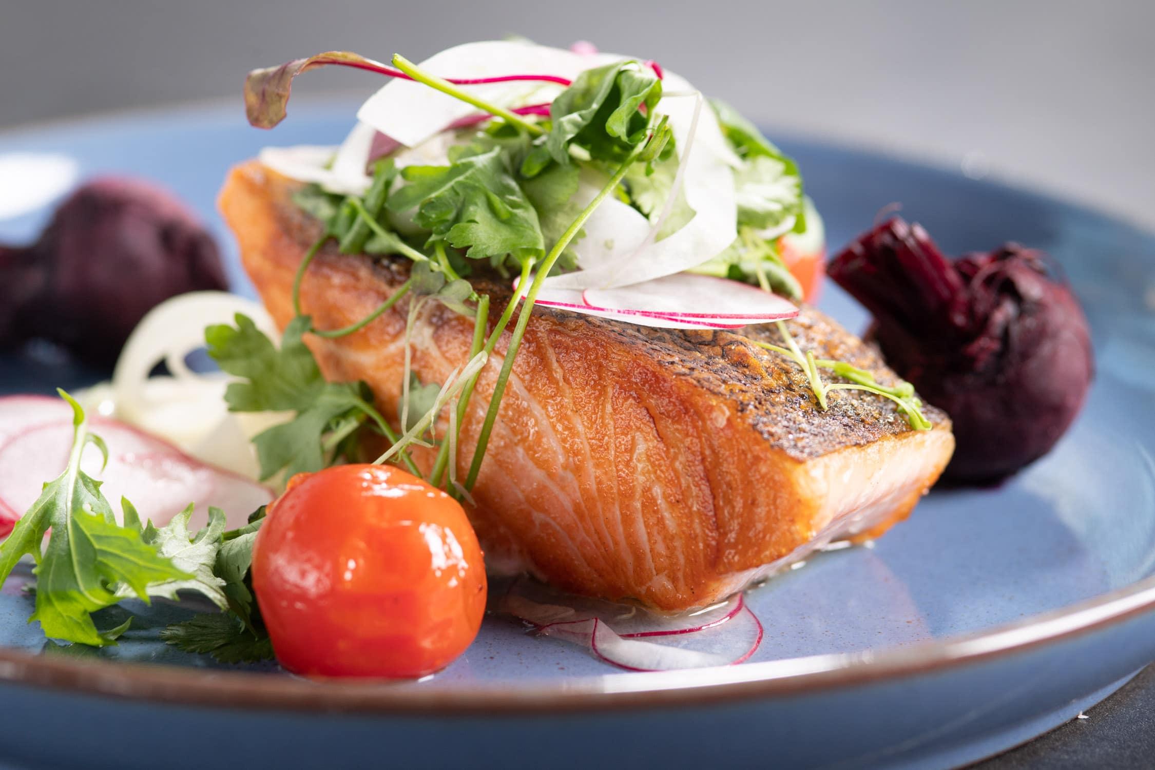 Salmon dish as Saros Bar + Dining