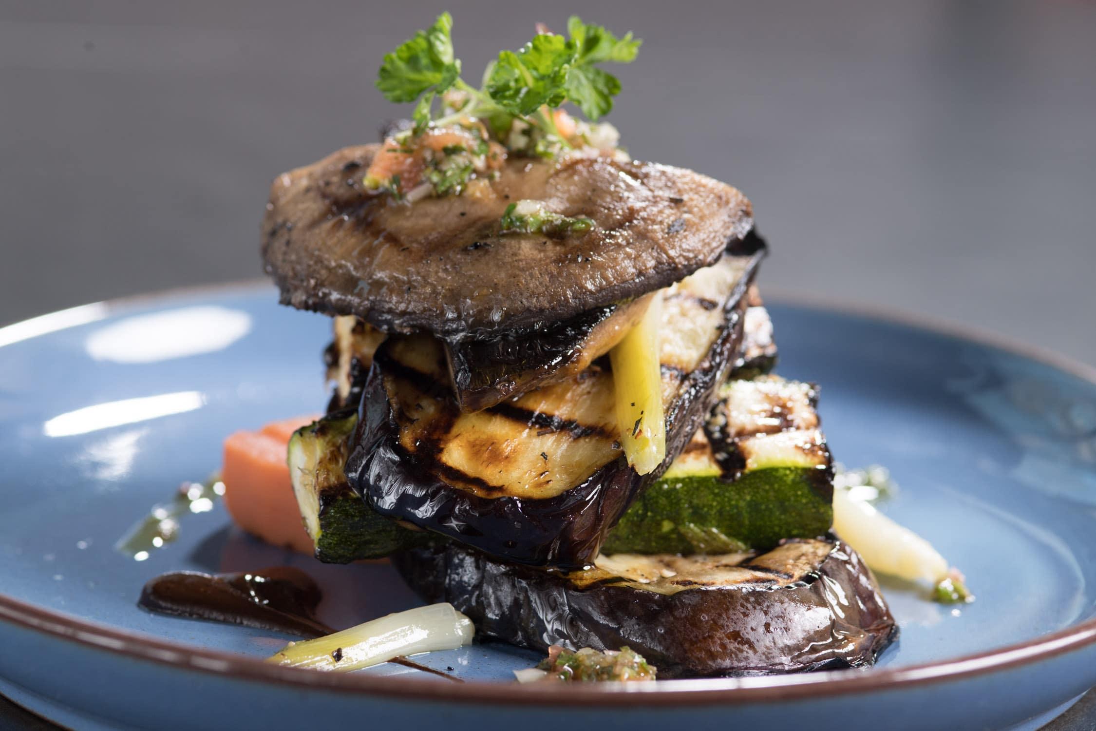 Egglplant, zucchini and mushroom vegetarian dish at Saros Bar + Dining